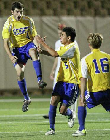 Alamo Heights' Alek Strimple (from left) celebrates with teammates Jesus Espin, and Robert Weigel after scoring against Wichita Falls Rider during overtime action of their Class 4A state final game Saturday, April 21, 2012 at Birkelbach Field in Georgetown. Alamo Heights won 3-2 in a shootout. Photo: EDWARD A. ORNELAS, San Antonio Express-News / © SAN ANTONIO EXPRESS-NEWS (NFS)