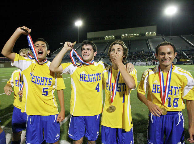 Alamo Heights' Jesus Espin (from left), Alek Strimple, Austin Quinn and Arturo Espin celebrate their 3-2 shootout win over Wichita Falls Rider in the Class 4A state final game Saturday, April 21, 2012 at Birkelbach Field in Georgetown. Photo: EDWARD A. ORNELAS, San Antonio Express-News / © SAN ANTONIO EXPRESS-NEWS (NFS)