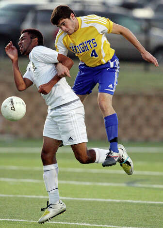 Wichita Falls Rider's Christian Okeke (left) and Alamo Heights' Alek Strimple go after the ball during first half action of their Class 4A state final game held Saturday, April 21, 2012 at Birkelbach Field in Georgetown. Photo: EDWARD A. ORNELAS, San Antonio Express-News / © SAN ANTONIO EXPRESS-NEWS (NFS)