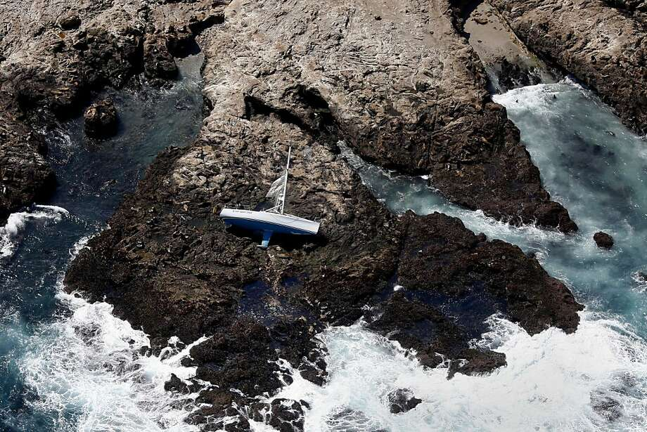 The Low Speed Chase lies on its side on the rocks of the Farallon Islands off the coast of San Francisco, on Saturday, April 14, 2012.  In the worst yacht racing accident in Northern California in three decades, five sailing crew members were killed when the boat crashed onto the rocks during a race around the islands. (Brant Ward/San Francisco Chronicle) -- NO SALES Photo: Brant Ward, New York Times