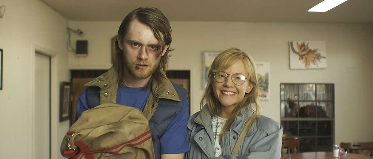 Rachael Harris as a sex-deprived wife and Matt O'Leary as her husband's newly-discovered druggie son in a scene from