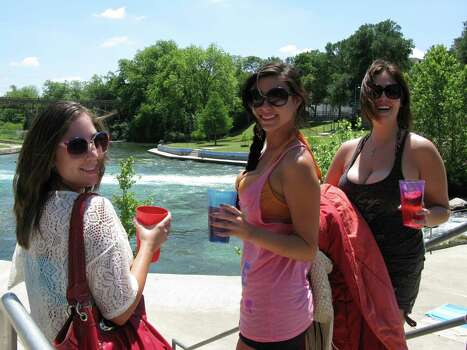 Critics of New Braunfels ban on disposable containers include (left to right) Desiree Broussard, Marcela Wright and  Tara Mueller, who arrived at the Comal River on Wednesday with Four Loko in hard plastic cups. Photo: Zeke MacCormack, San Antonio Express-News / San Antonio Express-News