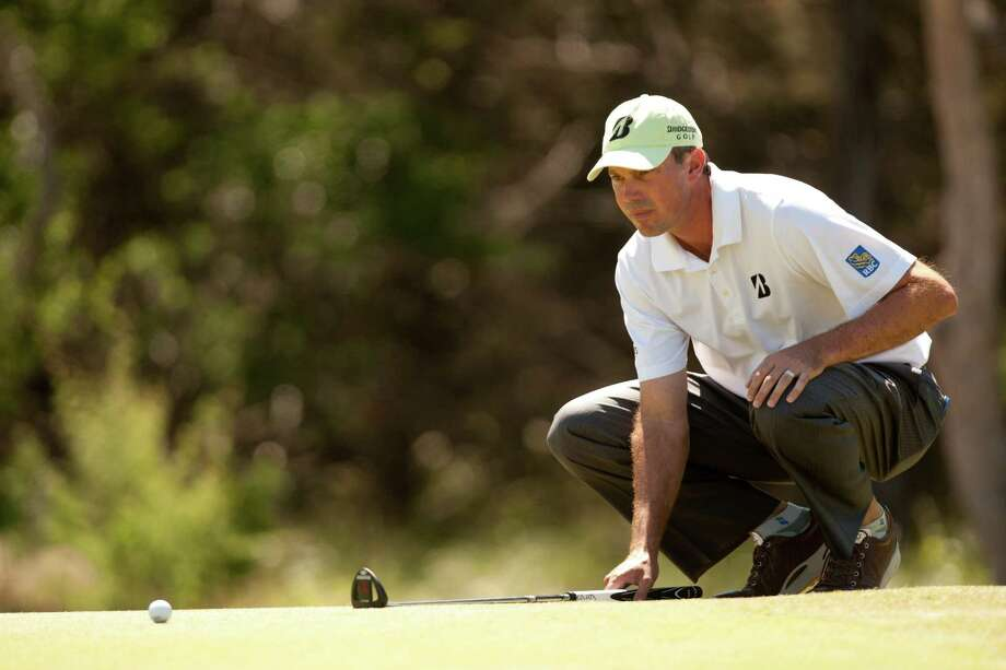 Matt Kuchar lines up a putt during the final round of the Valero Texas Open at the AT&T Oaks Course at TPC San Antonio on April 22, 2012 in San Antonio, Texas. Photo: Darren Carroll, Getty Images / 2012 Getty Images