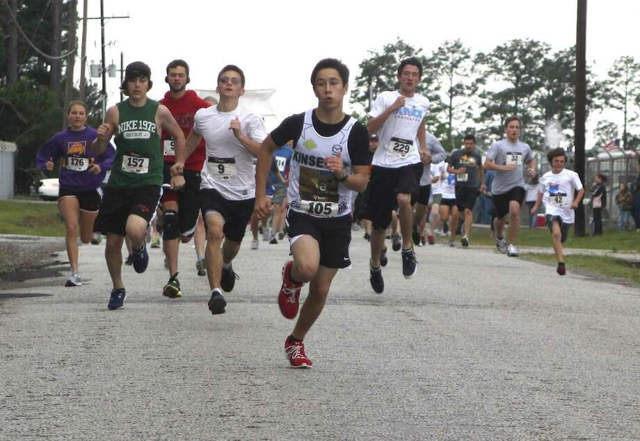 14-year-old Julian Perez takes the lead at the start of the Village Creek Festival 5K Run. Perez retained his lead and finished first overall in a time of 17 minutes, 35 seconds. Over 300 runners participated in the 5K Run on Saturday, April 21. There were also about 70 participants in the Kids K event that followed. Photo: David Lisenby, HCN_5k