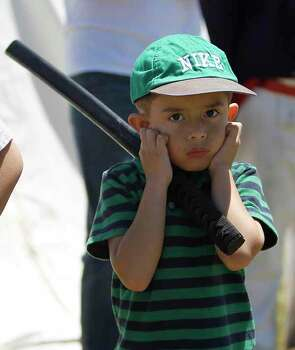 Miguel Hernandez, 6, of Humble, covers his ears as a cannon is fired by reenactors dressed in Mexican army uniforms fire during festivities before the start of the San Jacinto battleground reenactment commemorating the 176th anniversary of the battle of San Jacinto at the San Jacinto battleground, Saturday, April 21, 2012, in Houston. Photo: Karen Warren, Houston Chronicle / © 2012  Houston Chronicle