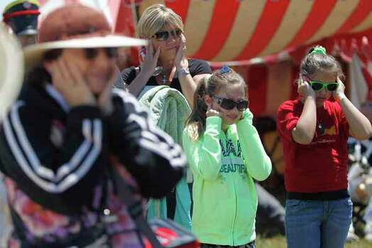 People cover their ears as a cannon is fired by reenactors dressed in Mexican army uniforms fire during festivities before the start of the San Jacinto battleground reenactment commemorating the 176th anniversary of the battle of San Jacinto at the San Jacinto battleground, Saturday, April 21, 2012, in Houston. Photo: Karen Warren, Houston Chronicle / © 2012  Houston Chronicle