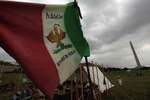 A flag is set at the Mexican Army camp where history reenactors are setting up in preparation for the reenactment of the Battle of San Jacinto over the weekend on Friday, April 20, 2012, in La Porte.  The reenactment of the Battle of San Jacinto will be Saturday, April 21 at 3 p.m. near the reflection pool at the San Jacinto Monument. Photo: Mayra Beltran, Houston Chronicle / © 2012 Houston Chronicle