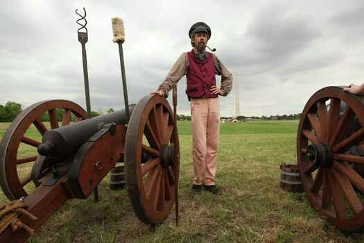 Jim Glover, dressed in period clothing, smokes a pipe at the Texas Army civilian camp where other reenactors are setting up in preparation for the reenactment of the Battle of San Jacinto over the weekend on Friday, April 20, 2012, in La Porte.   The reenactment of the Battle of San Jacinto will be Saturday, April 21 at 3 p.m. near the reflection pool at the San Jacinto Monument. Photo: Mayra Beltran, Houston Chronicle / © 2012 Houston Chronicle