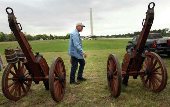 George Rollow, San Jacinto Volunteer, is in charge of cannons and inspects them before the rain as the volunteers prepare for the reenactment of the Battle of San Jacinto on Friday, April 20, 2012, in La Porte. Photo: Mayra Beltran, Houston Chronicle / © 2012 Houston Chronicle