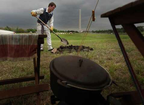 Michael Sproat digs fire pit his tent at the Texas Army civilian camp where history reenactors are setting up for the reenactment of the Battle of San Jacinto on Friday, April 20, 2012, in La Porte. The reenactment of the Battle of San Jacinto will be Saturday, April 21 at 3 p.m. near the reflection pool at the San Jacinto Monument. Photo: Mayra Beltran, Houston Chronicle / © 2012 Houston Chronicle