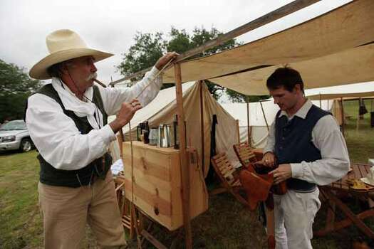 Reenactors Mark Hegman and Michael Sproat add finishing touches to their living area at the Texas Army civilian camp where history reenactors are setting up camp for the reenactment of the Battle of San Jacinto on Friday, April 20, 2012, in La Porte. Photo: Mayra Beltran, Houston Chronicle / © 2012 Houston Chronicle