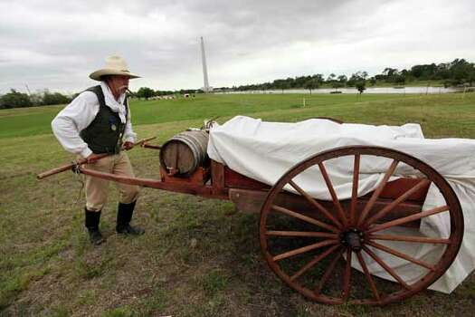 Mark Hegman relocates wagon at the Texas Army civilian camp where  history reenactors are setting up camp in preparation for the  reenactment of the Battle of San Jacinto on Friday, April 20, 2012, in La Porte. Photo: Mayra Beltran, Houston Chronicle / © 2012 Houston Chronicle
