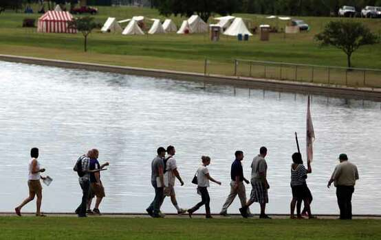 Stephen F. Austin State University's ROTC program tours the San Jacinto Monument and battleground as history reenactors set up tents at the state historic site in preparation for the reenactment of the Battle of San Jacinto over the weekend on Friday, April 20, 2012, in La Porte. Photo: Mayra Beltran, Houston Chronicle / © 2012 Houston Chronicle