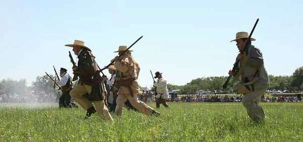 Reenactors dressed as Texian soldiers charge toward the Mexican camp during the battle reenactment commemorating the 176th anniversary of the battle of San Jacinto at the San Jacinto Battleground, Saturday, April 21, 2012, in Houston. Photo: Karen Warren, Houston Chronicle / © 2012  Houston Chronicle