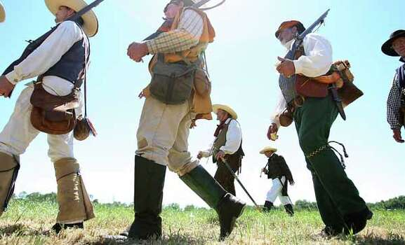 Reenactors dressed as Texian soldiers along the battlefield during the battle reenactment commemorating the 176th anniversary of the battle of San Jacinto at the San Jacinto Battleground, Saturday, April 21, 2012, in Houston. Photo: Karen Warren, Houston Chronicle / © 2012  Houston Chronicle