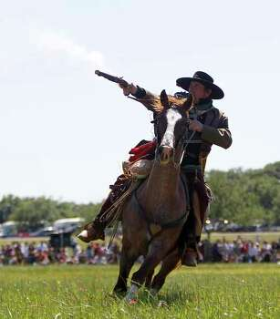 A Texian Army reenactor fires a gun while on horseback during the battle reenactment commemorating the 176th anniversary of the battle of San Jacinto at the San Jacinto Battleground, Saturday, April 21, 2012, in Houston. Photo: Karen Warren, Houston Chronicle / © 2012  Houston Chronicle