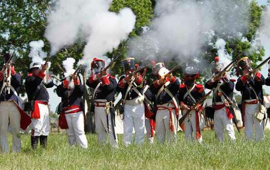Reenactors dressed in Mexican army uniforms fire at Texian soldiers  during the San Jacinto battleground reenactment commemorating the 176th anniversary of the battle of San Jacinto at the San Jacinto battleground, Saturday, April 21, 2012, in Houston. Photo: Karen Warren, Houston Chronicle / © 2012  Houston Chronicle