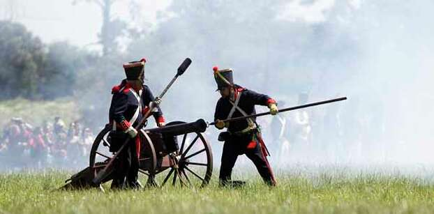 Reenactors dressed in Mexican army uniforms prepare to fire a cannon during the San Jacinto battleground reenactment commemorating the 176th anniversary of the battle of San Jacinto at the San Jacinto battleground, Saturday, April 21, 2012, in Houston. Photo: Karen Warren, Houston Chronicle / © 2012  Houston Chronicle