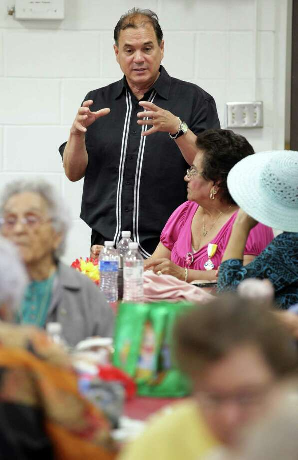 "Sergio ""Chico"" Rodriguez, who is running for reelction as Precinct 1 Commissioner, talks with seniors including Lupe Salazar, right, as he visits south side residents having lunch at Harlandale Senior Center at Harlandale Civic Center, Tuesday, April 17, 2012. Photo: BOB OWEN, San Antonio Express-News / © 2012 San Antonio Express-News"