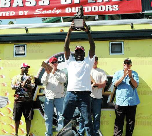 John Martin of Beaumont celebrates winning the Big Bass Splash tournament Sunday at Lake Sam Rayburn. Photo: Patty Lenderman, JN_McD Champion