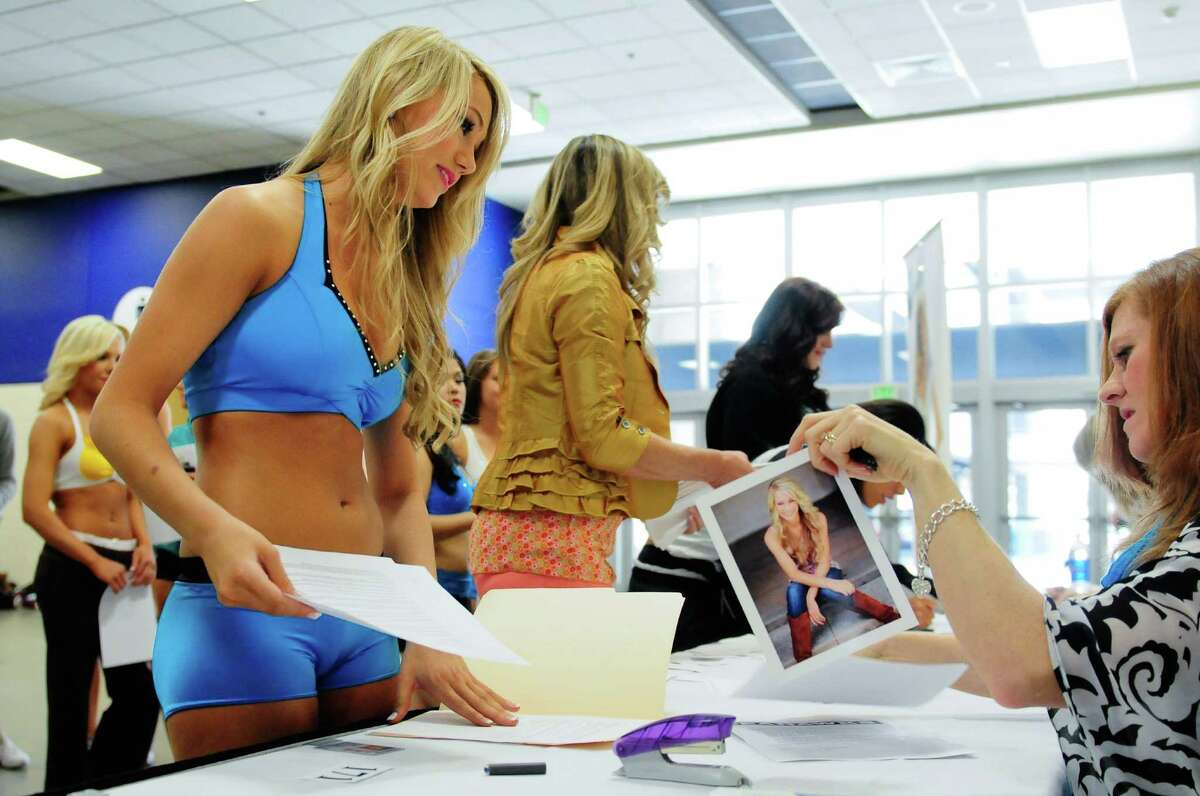 Cori Mulholland from Snohomish checks in during the first round of the Seahawks' Sea Gals auditions at CenturyLink Event Center on Sunday, April 22, 2012. A little less than half of the more than 170 women who tried out were called back to continue into the April 29 semifinal round. The final 2012 Sea Gals squad will consist of about 23-32 members and will make more than 300 public appearances in a year.