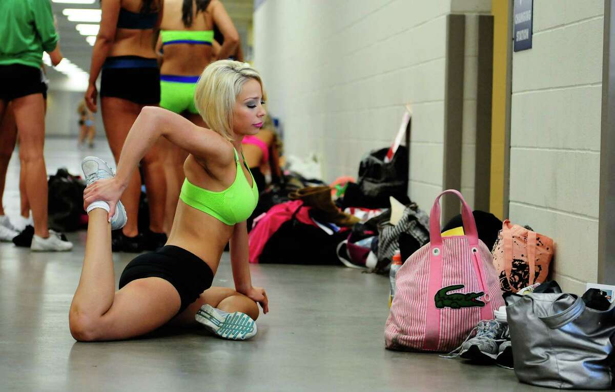 Lauren James stretches in preparation during the first round of the Seahawks' Sea Gals auditions at CenturyLink Event Center on Sunday, April 22, 2012. A little less than half of the more than 170 women who tried out were called back to continue into the April 29 semifinal round. The final 2012 Sea Gals squad will consist of about 23-32 members and will make more than 300 public appearances in a year.