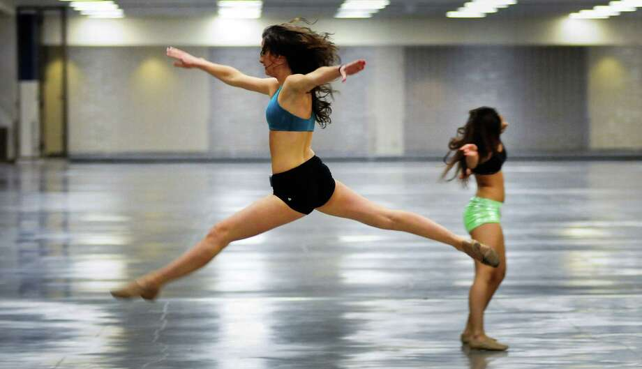 Ariel Zak, center, leaps during her routine. Photo: LINDSEY WASSON / SEATTLEPI.COM