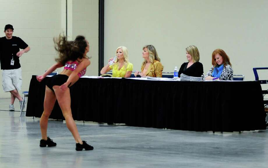 A contestant approaches the table during her routine. Photo: LINDSEY WASSON / SEATTLEPI.COM