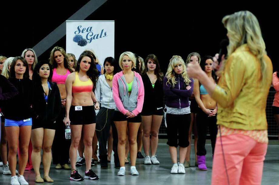 Contestants wait anxiously as Sea Gals director Sherri Thompson announces who will move on after the first round. Photo: LINDSEY WASSON / SEATTLEPI.COM