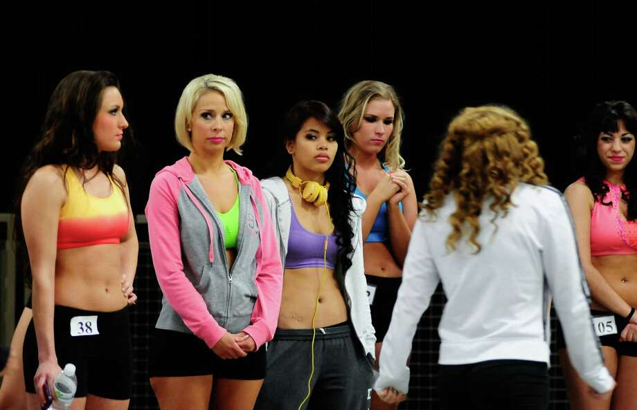 Contestants wait anxiously as Sea Gals director Sherri Thompson announces who will move on after the first round of the Seahawks' Sea Gals auditions. Photo: LINDSEY WASSON / SEATTLEPI.COM