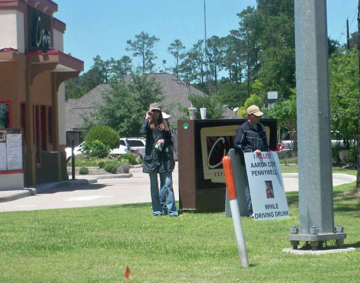 """Michael Giacona holds a sign reading """"I killed Aaron Pennywell"""" at the intersection of Huffmeister and Spring Cypress as part of his punishment handed down by a Harris County judge. (Photo courtesy of Pam Lewandowski)"""