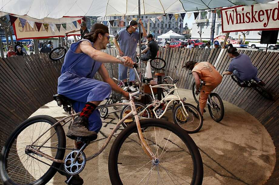 The Whiskeydrome was set up in the plaza and featured daredevil cyclists who flew around a circular course. A celebration of Earth Day 2012 was held at the Civic Center Plaza in front of San Francisco's City Hall Sunday April 22, 2012. Photo: Brant Ward, The Chronicle