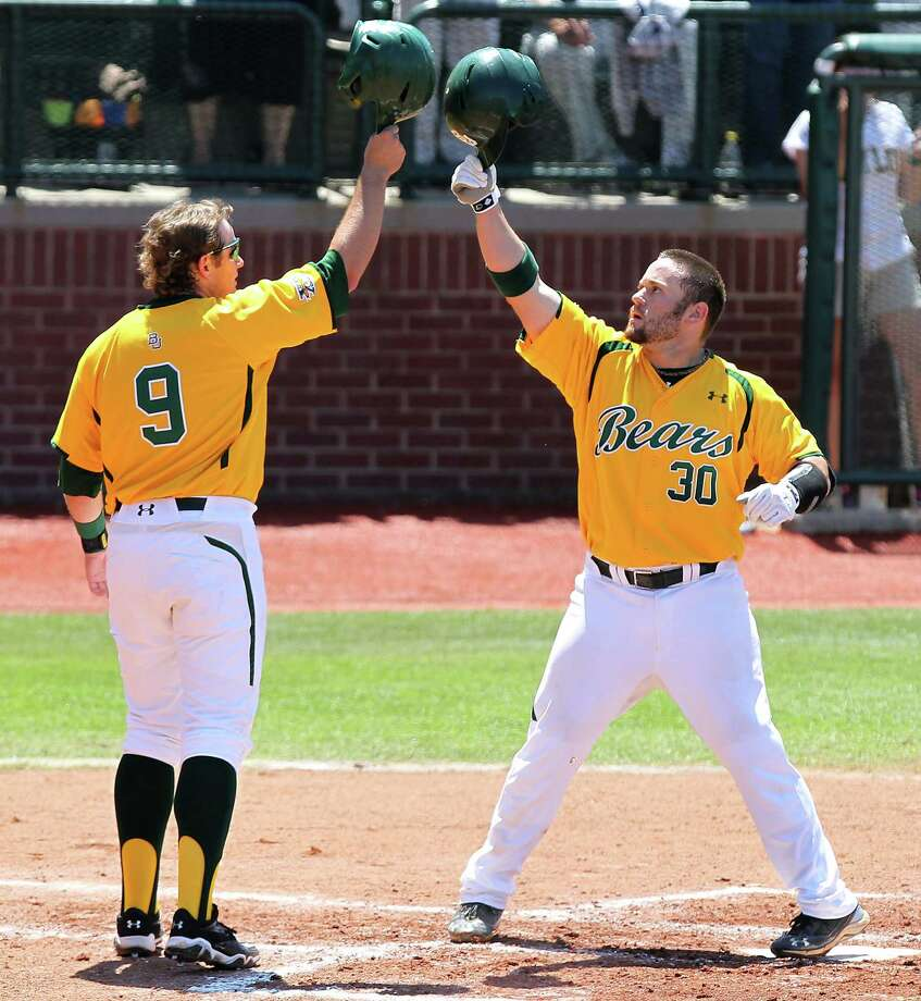 Baylor's Max Muncy, left, helps Josh Ludy celebrate his first-inning homer in the Bears' 24th straight win. Photo: Jerry Larson / Waco Tribune Herald