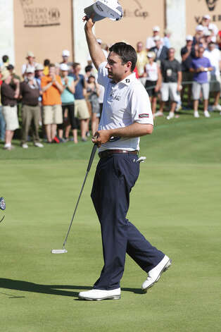 Ben Curtis acknowledges the gallery after winning the 2012 Valero Texas Open at TPC San Antonio, Sunday, April 22, 2012. Curtis ended with a nine-under-par. Matt Every and John Huh tied for second at 7-under-par. Jerry Lara/San Antonio Express-News Photo: Jerry Lara, Express-News / © San Antonio Express-News