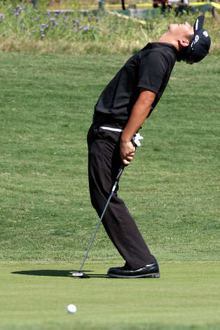 John Huh reacts after missing a birdie putt on the 15th green during final day of the 2012 Valero Texas Open at TPC San Antonio, Sunday, April 22, 2012. Ben Curtis ended with a nine-under-par to win the tournament. Matt Every tied for second with Huh. Jerry Lara/San Antonio Express-News Photo: Jerry Lara, Express-News / © San Antonio Express-News
