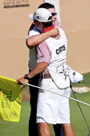 Ben Curtis hugs his caddy, Ricky Elliott aftet winning the 2012 Valero Texas Open at TPC San Antonio, Sunday, April 22, 2012. Curtis ended with a nine-under-par with his playing partners, Matt Every and John Huh tying for second. Jerry Lara/San Antonio Express-News Photo: Jerry Lara, Express-News / © San Antonio Express-News