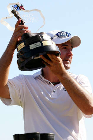 Ben Curtis holds the trophy after winning the 2012 Valero Texas Open at TPC San Antonio, Sunday, April 22, 2012. Curtis ended with a nine-under-par with his playing partners, Matt Every and John Huh tying for second. Curtis took home a check for $1.16 million. Jerry Lara/San Antonio Express-News Photo: Jerry Lara, Express-News / © San Antonio Express-News