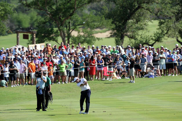 Ben Curtis hits from the 18th fairway during the 2012 Valero Texas Open at TPC San Antonio, Sunday, April 22, 2012. Curtis ended with a nine-under-par to win the tournament. Matt Every and John Huh tied for second at 7-under-par. Jerry Lara/San Antonio Express-News Photo: Jerry Lara, Express-News / © San Antonio Express-News