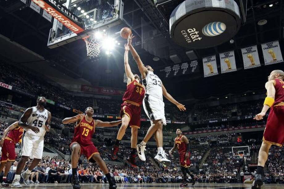 FOR SPORTS - San Antonio Spurs' Boris Diaw shoots around Cleveland Cavaliers' Omri Casspi during second half action Sunday April 22, 2012 at the AT&T Center. The Spurs won 114-98. (PHOTO BY EDWARD A. ORNELAS/SAN ANTONIO EXPRESS-NEWS) (SAN ANTONIO EXPRESS-NEWS)