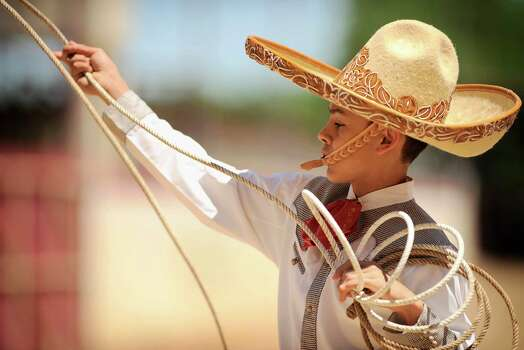 Fifteen-year-old charro Edmund Rios performs during the Fiesta Charreada, Sunday, April 22, 2012, in San Antonio. Photo: Darren Abate, Darren Abate/Special To The Express-News