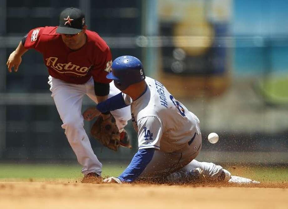 Dodgers left fielder Jerry Hairston Jr. slides into second on a steal as the ball bounces away from Astros second baseman Jose Altuve. (Karen Warren / Chronicle)