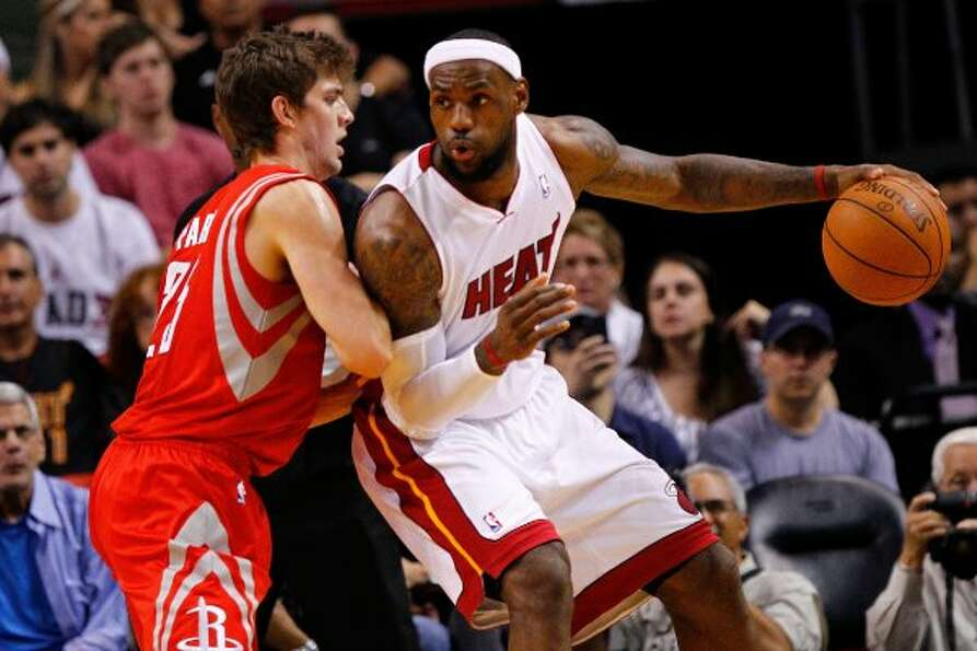 April 22: Heat 97, Rockets 88 Heat forward LeBron James, right, posts up Roc