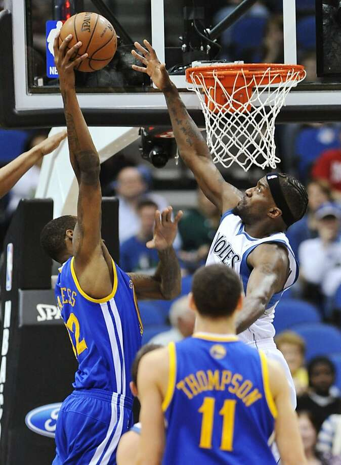 Minnesota Timberwolves' Martell Webster, right, attempts to block a shot by Golden State Warriors' Mickell Gladness during the first half of an NBA basketball game Sunday, April 22, 2012, in Minneapolis. (AP Photo/Jim Mone) Photo: Jim Mone, Associated Press