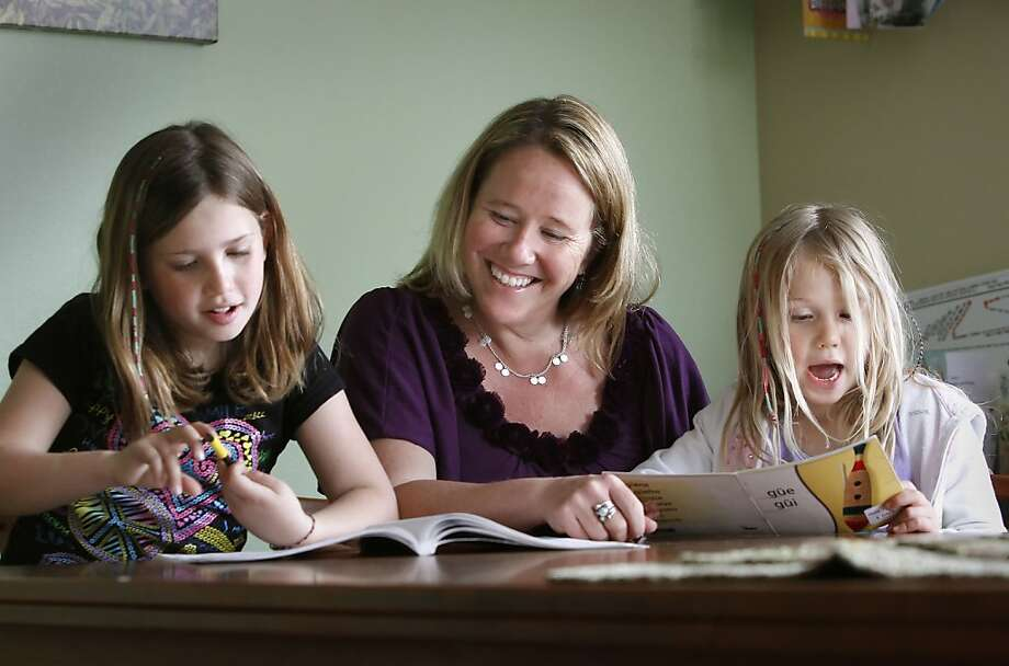 Raychel Kubby Adler with her two daughters, Marley, 9 and Ruby, 6 doing after school homework at their  Davis, Ca. home,  on Wednesday April 18, 2012. A year and a half after Raychel Kubby Adler discovered she carried a genetic mutation that gave her an 87 percent lifetime chance of developing breast cancer, she opted to have a prophylactic double mastectomy at age 36. She has a new online tool to help her weigh her options. Using the interactive tool, which was developed by Stanford University School of Medicine researchers, Kubby Adler learned her risk of developing ovarian cancer may remain relatively low whether she has the surgery now at age 40 or waits until sheís 45. Photo: Michael Macor, The Chronicle