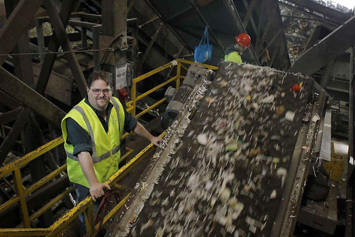 Recology's David Nanney stands by a sorting conveyer belt at the company's facility in San Francsico, Calif., on Tuesday, April 17, 2012. Last fall, Nanney and other Recology workers began plucking BART tickets out of the unrecyclable bits bound for the landfill, and donating them to the Tiny Tickets program, which allows charities to cash in the tickets. In four months, they raised $1,400, which they donated to the San Francisco Food Bank. Now Recology is planning to extend that effort, allowing people to tape unused BART tickets to trash bin lids, so collectors can gather and collect them, splitting the proceeds between the Food Bank and Friends of the Urban Forest.