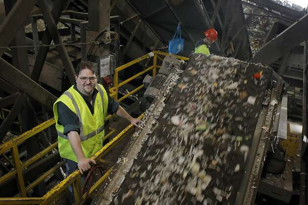 Recology's David Nanney stands by a sorting conveyer belt at the company's facility in San Francsico, Calif., on Tuesday, April 17, 2012. Last fall, Nanney and other Recology workers began plucking BART tickets out of the unrecyclable bits bound for the landfill, and donating them to the Tiny Tickets program, which allows charities to cash in the tickets. In four months, they raised $1,400, which they donated to the San Francisco Food Bank. Now Recology is planning to extend that effort, allowing people to tape unused BART tickets to trash bin lids, so collectors can gather and collect them, splitting the proceeds between the Food Bank and Friends of the Urban Forest. Photo: Carlos Avila Gonzalez, The Chronicle