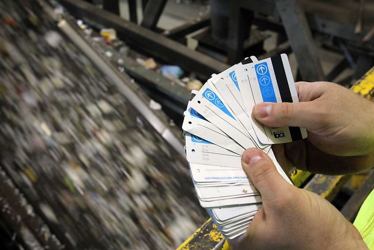 Recology's David Nanney holds recovered BART tickets by a sorting conveyer belt at the company's facility in San Francsico, Calif., on Tuesday, April 17, 2012. Last fall, Nanney and other Recology workers began plucking BART tickets out of the unrecyclable bits bound for the landfill, and donating them to the Tiny Tickets program, which allows charities to cash in the tickets. In four months, they raised $1,400, which they donated to the San Francisco Food Bank. Now Recology is planning to extend that effort, allowing people to tape unused BART tickets to trash bin lids, so collectors can gather and collect them, splitting the proceeds between the Food Bank and Friends of the Urban Forest.