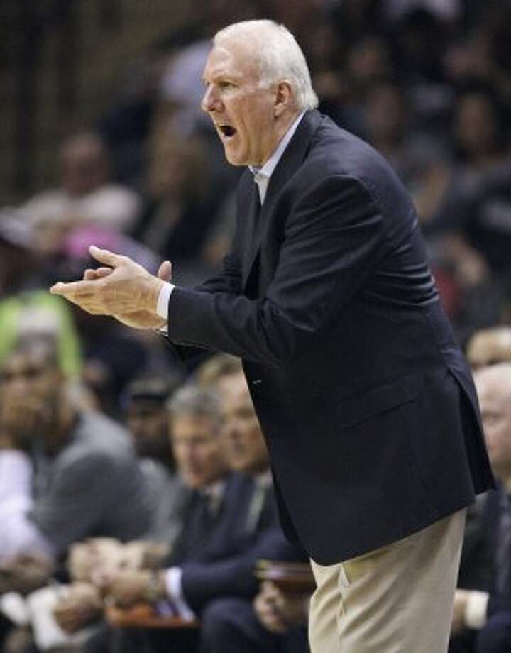 FOR SPORTS - San Antonio Spurs head coach Gregg Popovich yells instructions to the team against the Cleveland Cavaliers during second half action Sunday April 22, 2012 at the AT&T Center. The Spurs won 114-98. (PHOTO BY EDWARD A. ORNELAS/SAN ANTONIO EXPRESS-NEWS) (SAN ANTONIO EXPRESS-NEWS)