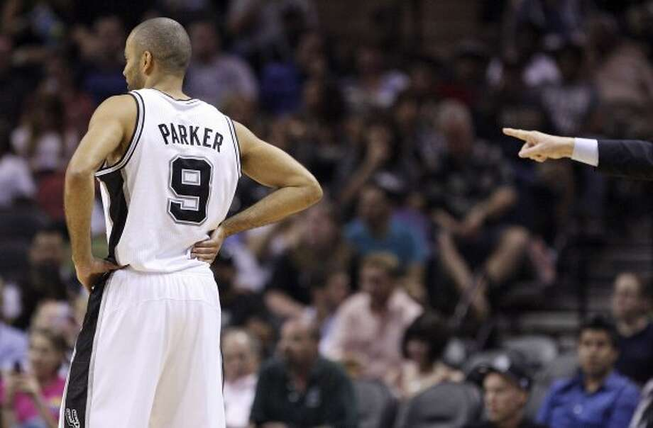 FOR SPORTS - San Antonio Spurs' Tony Parker pauses during second half action against the Cleveland Cavaliers Sunday April 22, 2012 at the AT&T Center. The Spurs won 114-98. (PHOTO BY EDWARD A. ORNELAS/SAN ANTONIO EXPRESS-NEWS) (SAN ANTONIO EXPRESS-NEWS)