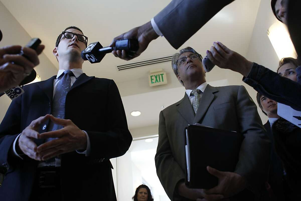 Attorney David Waggoner (l to r) answers questions from the media as suspended sheriff Ross Mirkarimi listens at the San Francisco Civic Center Courthouse with on Friday, April 20, 2012 in San Francisco, Calif.